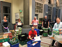Inverclyde Council staff volunteer to sort and distribute two tonnes of food to community groups supporting vulnerable people