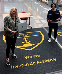 A new joint-initiative involving Inverclyde Council, Inverclyde HSCP and Belville Community Garden Trust has been launched to provide laptops to disadvantaged school pupils to help with their home learning during lockdown. Pictured at Inverclyde Academy, one of the schools to benefit from the scheme, is depute head teacher Susan Chambers, left, and Laura Reilly, from Belville.