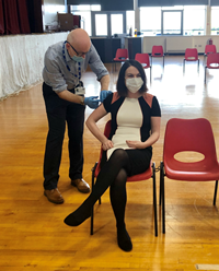 Inverclyde community flu vaccination programme at Port Glasgow Town Hall. Pictured receiving a jab is Inverclyde Health & Social Care Partnership (HSCP) chief officer Louise Long