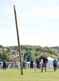 Lucas Venta tossing the caber in the final event before becoming 2019 Champion