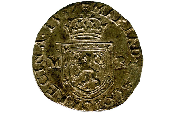 A Queen Mary Testoon coin from the Greenock Coin Hoard. The coin was valued at 5 shillings and was made of silver. This example is dated 1557 from the first period, type III. - 1978.422 © McLean Museum and Art Gallery, Greenock.