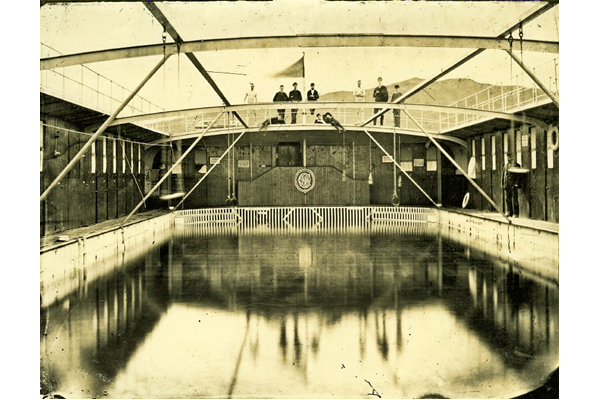 The Clyde Floating Swimming Bath Co. used a barge moored off Battery Park, Greenock to provide a bathing pool with attendants. It was unsuccessful and folded in the early 1880s. - Bromide print on paper - c 1880 - P4103 - © McLean Museum and Art Gallery, Greenock.