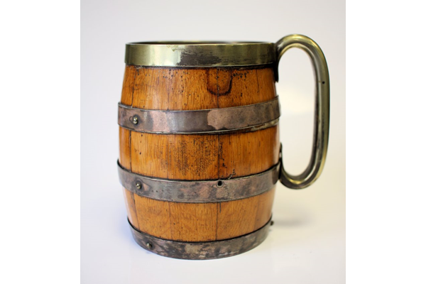 The tankard was used when Loch Thom become the reservoir for the Greenock water supply, and took the first water out of it at the opening. The wooden part of the tankard was made by Drummond, a local cooperage firm. - 2015.13 - © McLean Museum and Art Gallery, Greenock