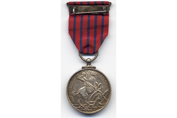 This George Medal was awarded to William Neill (d 1942) of Greenock Fire Station for his heroic action during the Greenock blitz on the night of the 7th-8th May 1941. - 2000.41 - © McLean Museum and Art Gallery, Greenock