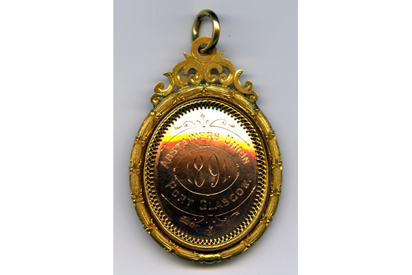 Gold medal awarded by the Abstainer's Union, Port Glasgow to Robert Thomson (d 1940) in 1891 in the competition for solo vocalist. - 2009.66 - © McLean Museum and Art Gallery, Greenock