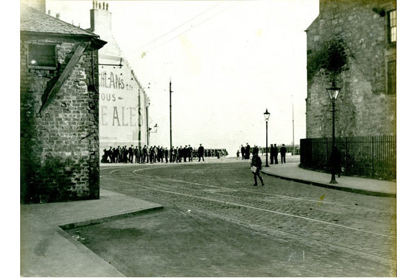Crowds of men gathered at the corner of Scarlow Street and Fore Street, Port Glasgow. - 2009.98.17 - © McLean Museum and Art Gallery, Greenock