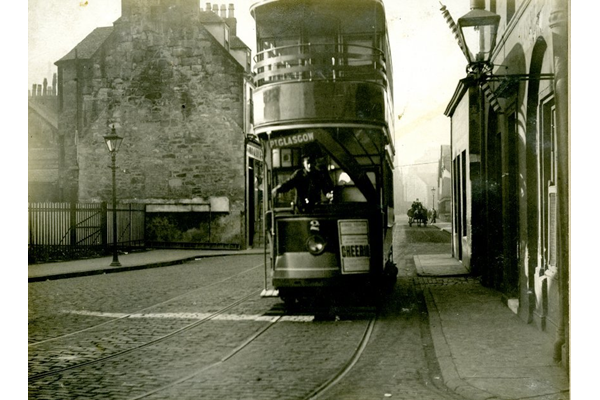 The corner of Scarlow Street and Fore Street, Port Glasgow looking West, showing a double-decker tramcar. - 2009.98.18 - © McLean Museum and Art Gallery, Greenock