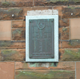 The memorial, known locally as 'The Toll Boys Memorial' is in the form of a wall plaque located at No. 5 Robert Street, Port Glasgow.