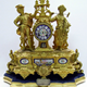 19th century gold painted cast iron presentation clock. The is inscribed: 'Presented to Mr. Thomas D. Rorison (along with a gem ring to Mrs Rorison) by the employees of Messrs. Crawhall Allison & Co. Sugar Refinery as a token of esteem, on the occasion of his leaving the works to occupy a better position. Greenock 14th July 1877'.  - 1998.11 ©McLean Museum and Art Gallery, Greenock.