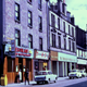 Transparency taken by Eugene Jean Méhat (1920-2000) showing a view of West Blackhall Street, Greenock in the 1960s with the Sea Palace Chinese restaurant and Televiewer shop. - 2008.72.86  - © McLean Museum and Art Gallery, Greenock.