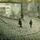 The upper part of Chapel Lane, Port Glasgow in the 1920s with children playing and a cobbled lane. - 2009.98.10 - © McLean Museum and Art Gallery, Greenock