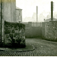 Chapel Lane, Port Glasgow, South of the railway bridge with a cobbled lane and telegraph poles. - 2009.98.11 - © McLean Museum and Art Gallery, Greenock