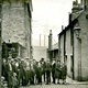 Back Row Lane, Port Glasgow from Chapel Lane with a crowd of men, women and children. - 2009.98.14 - © McLean Museum and Art Gallery, Greenock