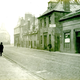 Shops and pub at Scarlow Street, Port Glasgow with tram lines visible. - 2009.98.41 - © McLean Museum and Art Gallery, Greenock