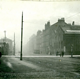 Port Glasgow Road looking East showing the  Greenock - Port Glasgow boundary. The boundary is shown as a white line. - 2009.98.4 - © McLean Museum and Art Gallery, Greenock